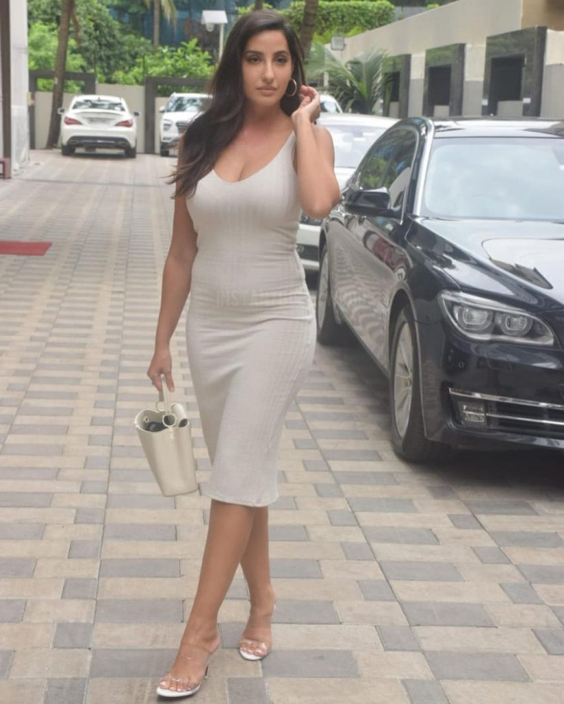 Nora Fatehi in off-white bodycon dress tempting Indian media reporters